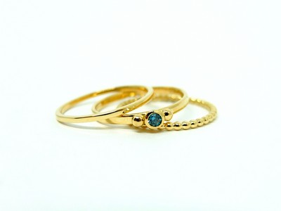 Ring-750er-GG-mit-006ct-blauem-Diamanten-Goldkugeln-1